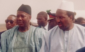 President Ahmed Tejan Kabbah of Sierra Leone, in blue, and Alpha Konare,  president of Mali, during the reinstatement of Kabbah in 1998.