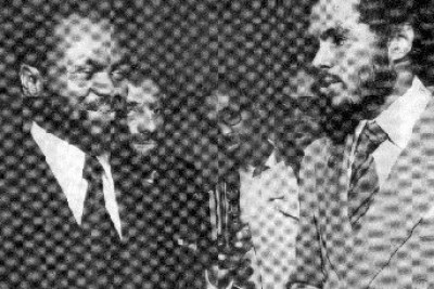 Robert Van Lierop, right, presents a check to President Samora Machel of Mozambique at the United Nations in 1977 . The funds, raised from Van Lierop's film showings across the country, went to build a health clinic in rural Niassa province. In the background, from left, are Valeriano Ferrpo, James Garrett, and an unidentified man.