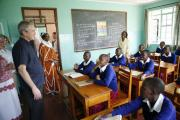 Former U.S. President George W. Bush visits with students in a classroom in Arusha, Tanzania (file photo).