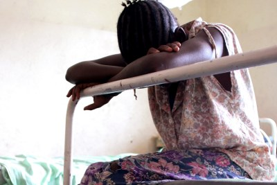 A young girl waits for treatment.