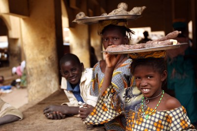Children selling cassava roots near Timbuktu (file photo).