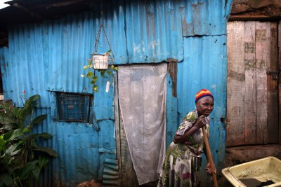 An elderly woman in a slum in Kenya.