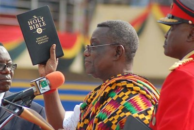 President John Atta Mills is sworn in during a ceremony in Independence Square, Accra.