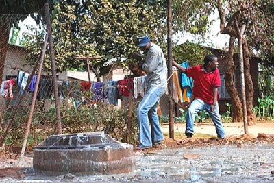 Sewage overflows outside homes in Kuwadzana 3 township in Harare (file photo).