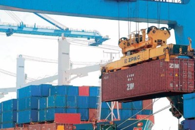 A container is offloaded from a ship at Mombasa port.