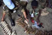 A United Nations peacekeeper inspects an arms cache in DR Congo (file photo).
