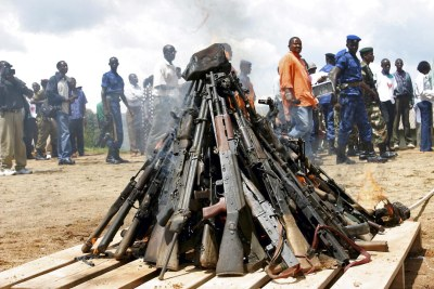 Weapons being burnt during the official launch of the Disarmament, Demobilization, Rehabilitation and Reintegration (DDRR) process in Muramvya, Burundi. Burundian military signed up voluntarily to be disarmed under the auspices of United Nations peacekeepers and observers.