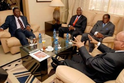 President Jacob Zuma meeting with President Robert Mugabe, Prime Minister Morgan Tsvangirai and Deputy Prime Minister Arthur Mutambara at the Rainbow Towers Hotel in Harare (file photo).