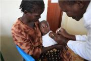Trial participant being vaccinated, Siaya District hospital, by the PATH Malaria Vaccine Initiative.