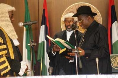 President Goodluck Jonathan, led by Chief Justice Katsina Alu, takes the oath of office.