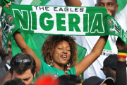 A Super Eagles fan displays her support a match.