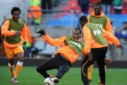 Ivory Coast's Didier Drogba, middle, warms up prior to kick-off with teammates