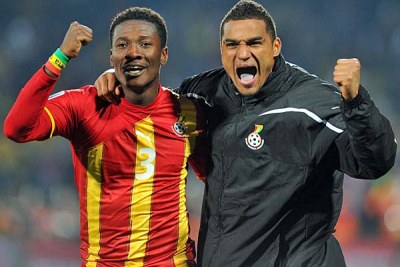 Asamoah Gyan, left, and Kevin Prince Boateng of Ghana celebrate their team's win.