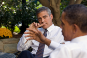 U.S. President Barack Obama discusses the situation in Sudan with actor George Clooney in 2010.