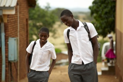 Lazarus and his schoolmate Hasani walk back to the boys shelter after finishing lessons for the day.