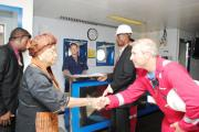 President Sirleaf meets an oil worker during a tour of an exploration rig (file photo).
