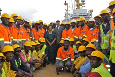 Billionaire Lakshmi Mittal, at middle, joined his Liberian workers to mark a key step in post-civil war recovery. With them is President Ellen Johnson Sirleaf.