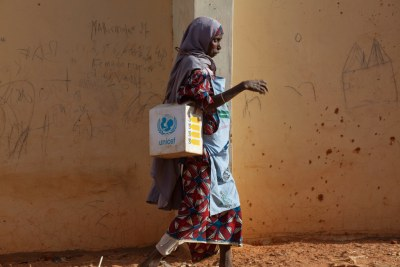 A local health worker carries polio vaccines in Nigeria (file photo).
