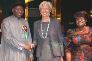 International Monetary Fund's Managing Director Christine Lagarde (2nd R) is greeted by Nigeria's President Goodluck Jonathan (2nd L) as Mrs. Ngozi Okonjo-Iweala, Coordinating Minister for the Economy and Minister of Finance (R) looks on December 19, 2011 at the Aso Rock Villa, State House in Abuja, Nigeria.