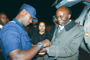 Léon Mugesera being handcuffed upon arrival at Kigali International Airport (file photo).