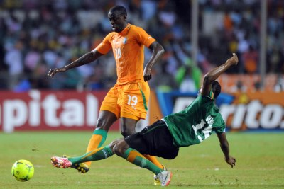 African player of the year for 2012 Yaya Toure - seen, left, against Stoppila Sunzu of Zambia at the last Afcon finals - will join Cote d'Ivoire's team at the 2013 finals in South Africa.