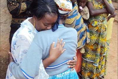Gerardine Mukakabego (L), a Rwandan refugee living in Zambia shed tears of joy when she met her mother for the first time since 1994.