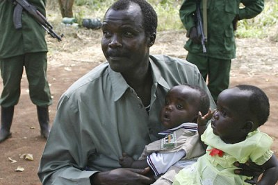 Joseph Kony, holds his daughter, Lacot, and son, Opiyo, at a past peace negotiation meet.