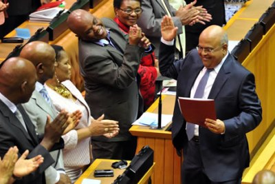 South Africa's Minister of Finance, Pravin Gordhan, right, in Parliament.
