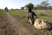 A young girl rests on the way to seek shelter after fleeing heavy fighting in Abyei (file photo).