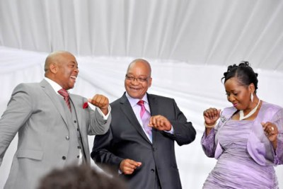 President Jacob Zuma, center, with his wife Bongi Ngema dance on their wedding day with Linda Sibiya who was host at the reception function.