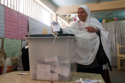 A woman casts her ballot at a Cairo polling station.