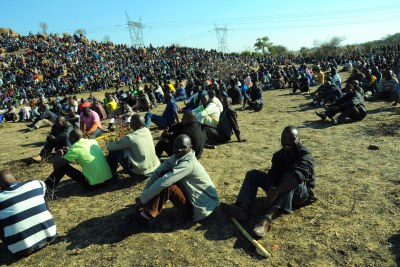 Striking Lonmin miners gather on a hill near the Marikana mine during a protest action in August 2012.