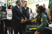 Sports Minister Fikile Mbalula greets Sandra Khumalo, one of Team SA's Paralympic athletes at OR Tambo International Airport in Johannesburg.