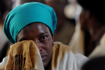A woman cries at a memorial service for slain miners in Marikana in the North West province.