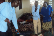 Residents view victims of ethnic violence at a mosque in the Tana Delta District (file photo).