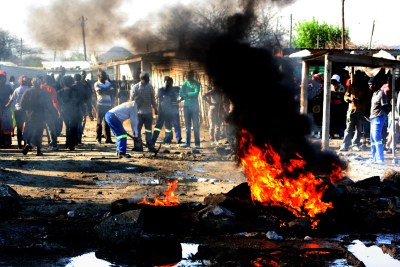 File photo: Striking miners erect burning barricades.