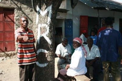 Youth stands next to wall marked MRC (Mombasa Republican Council) (file photo).