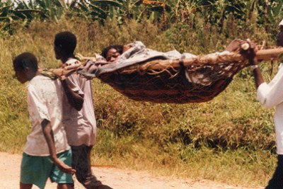 A woman being taken to hospital to deliver