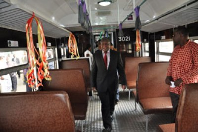 The Minister for Works Dr. Harrison Mwakyembe inspects one of the city commuter trains in Dar es Salaam.