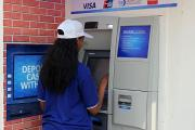 The latest innovation is a locally made product that will enable bank clients to use their normal ATM cards to pay for goods and services (file photo).