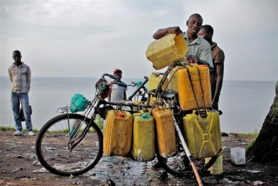 A man loads water collected from Lake Kivu onto his bicycle for sale in the city of Goma.