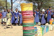 Pupils queue to fetch clean water in Yaeda Chini Valley (file photo).