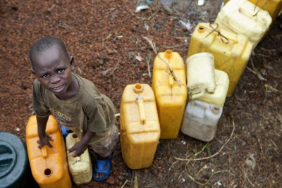 At the Kanyaruchinya internally displaced persons camp in Goma, a young boy waits to fill his containers at a water distribution area.