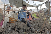 Displaced families in Mugunga camp near Goma contend with rocky volcanic soil and lack of food, water, medicines - and shelter from the rainy season, which has begun.