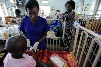 A young cancer patient receives care from a nurse at the Uganda Cancer Institute in Kampala (file photo).