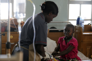 Nurse treating a young patient at the Uganda Cancer Institute.
