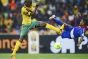 Anele Ngcongca of South Africa, left, tangles with Heldon of Cape Verde during  opening match of the 2013 Africa Cup of Nations finals.
