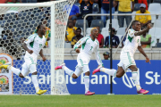 Emmanuel Emenike of Nigeria, no. 9, celebrates his opening goal in Friday's encounter with reigning champions Zambia. Five minutes before the end of the match, Nigeria conceded a penalty, and Zambian goalkeeper Kennedy Mweene equalised for the champions.