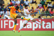 African Footballer of the Year Yaya Toure scoring one of Cote d'Ivoire's goals against Tunisia. He was central to most of the Ivorians' attacking moves in the match.