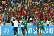 Burkinabe players and fans celebrate their progress to the Africa Cup of Nations quarter-finals.